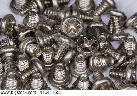 Background Of Cylindrical Self-threading Sheet Metal Screws With Cross Recessed Pan Head And White A