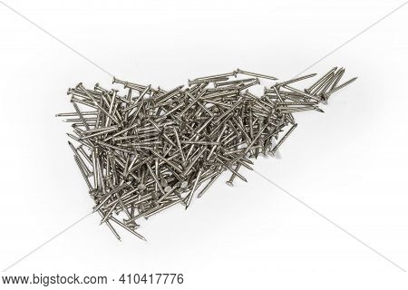 Pile Of The Small Steel Nails With White Anti Corrosion Coating On A White Background