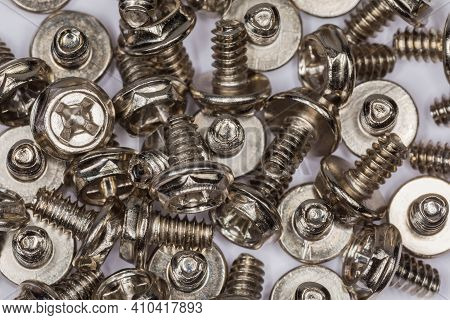 Pile Of Cylindrical Self-threading Sheet Metal Screws  With Combined Hex And Cross Recessed Head And