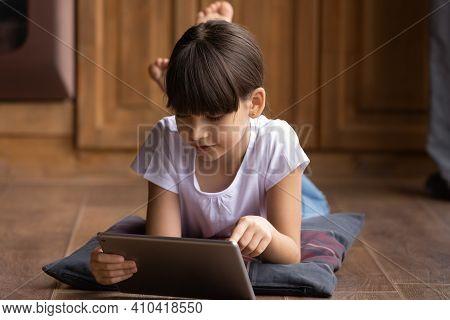 Small Latino Girl Use Modern Tablet Gadget