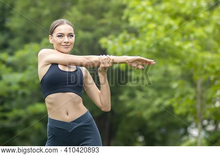 Sportive Fit Slim Girl In A Good Shape, Young Beautiful Happy Woman Doing Exercise, Workout In A Sum