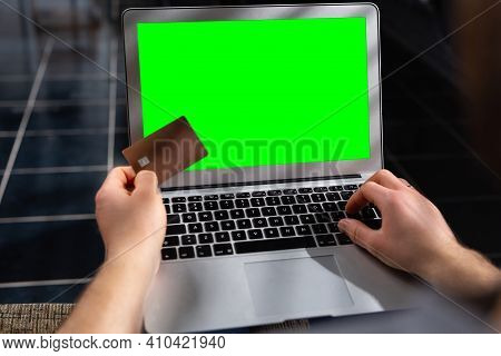 Businessman Holds A Credit Card For Online Purchases. Smart Payment Bank. Purchases Of Debit Savings