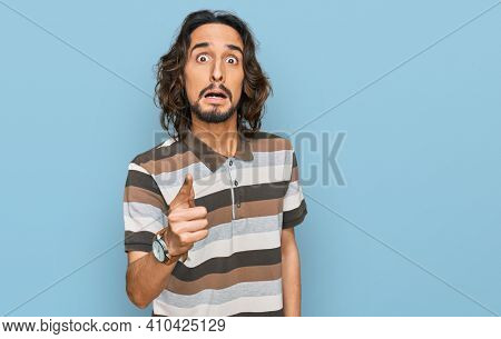 Young hispanic man wearing casual clothes pointing displeased and frustrated to the camera, angry and furious with you