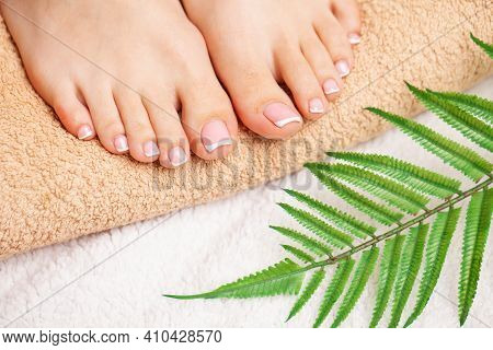 Closeup Photo Of A Female Feet At Spa Salon On Pedicure Procedure