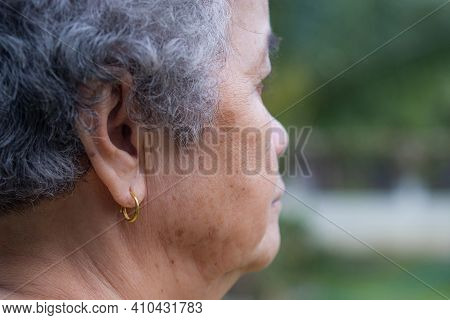 Side View Of Face Senior Woman Looking Away While Standing Outdoors. Space For Text. Concept Of Aged