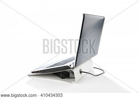 Use ring binder as a laptop stand isolated on white background