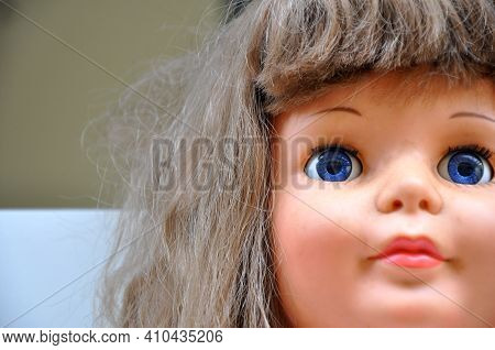 Doll. Closeup Of Doll Face, Doll Face In Zoom, In Pose, With Details Of The Eyes, Mouth, Nose And Ha