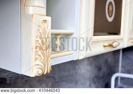 Selective Focus Fragment Of Beige Wooden Cabinetry Kitchen Carved Detail. Carved Decorative Detail.