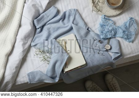 Flat Lay Composition With Soft Cashmere Sweater On Bed At Home