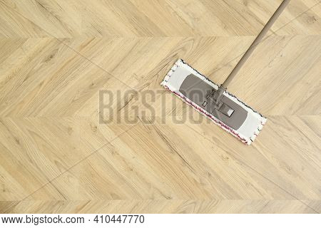 Cleaning Of Wooden Floor With Mop, Top View. Space For Text