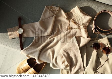 Soft Cashmere Sweater And Accessories On Sofa, Flat Lay