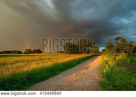 Storm Cloud With Rainbow, Dirt Road Through The Meadow, Nowiny, Eastern Poland