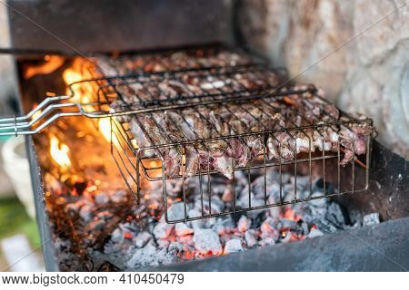 Lamb Ribs Cooked Over An Open Fire, Close-up In 4k. Lamb Chops Grilling Barbecue, Bbq Originally Mad