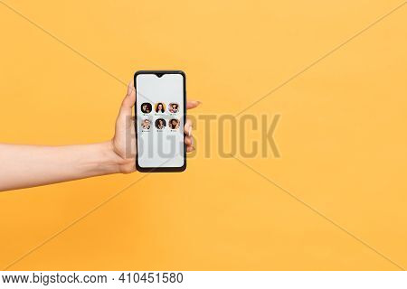 A Womans Hand Holds A Smartphone With The Club House App Interface On The Screen. Clubhouse Drop-in