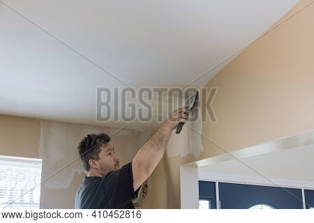 Home Interior Renovation On Coating Plastering Wall Putty Plaster On The Wall