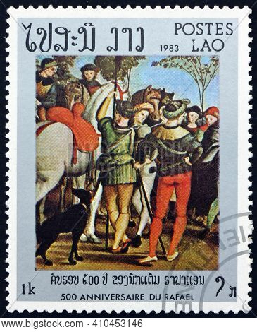 Laos - Circa 1983: A Stamp Printed In Laos Shows Adoration Of The Kings, Vatican, Florence, Painting