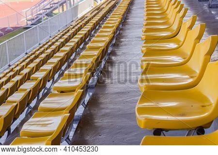 Row Of Yellow Stadium Seats In Thailand.
