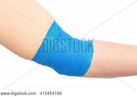Blue Elastic Bandage On The Elbow Joint On The Arm, White Background, Isolate. Elbow Fixation Concep