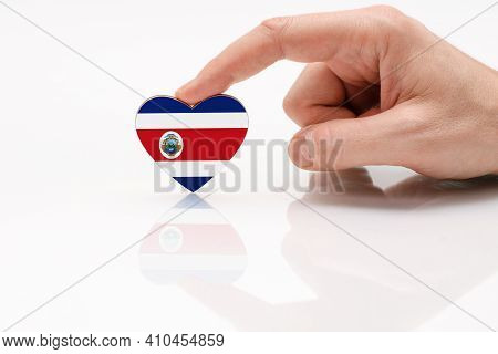 Costa Rica Flag. Love And Respect Costa Rica. A Man's Hand Holds A Heart In The Shape Of The Costa R