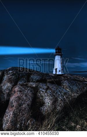 A Vertical Of Peggy\'s Cove Lighthouse, Nova Scotia, Canada At Night