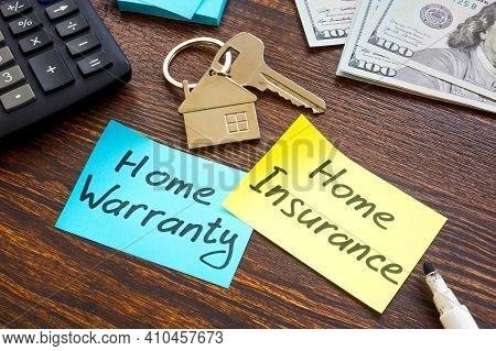 Home Warranty Vs Home Insurance And Key On The Desk.
