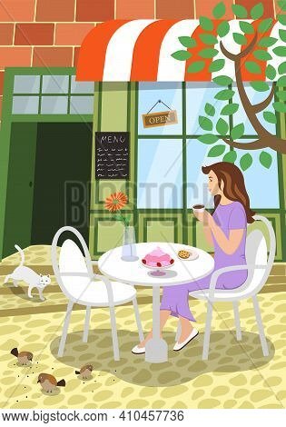 City Street Cafe Summer Scene. Girl Sits At Outdoors Restaurant Table Terrace Under Tree Holds Cappu