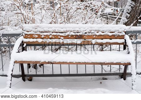Street Bench In The Snow. Heavy Snowfall. Snowfall Consequences. Streets Without Snow Removal
