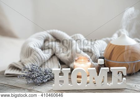 Aroma Composition With Modern Aroma Oil Diffuser On Wooden Surface With Knitted Element, Oils And Ca