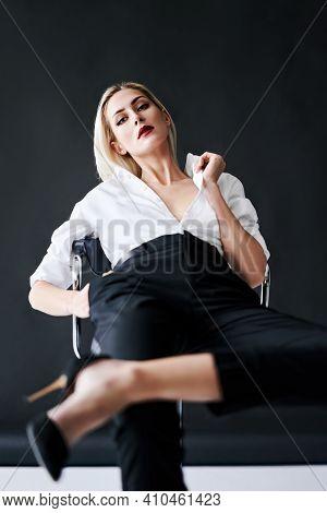 Fashion Portrait Of Daring Trendy Woman Posing On Black Studio Background. Gorgeous Stylish Blonde F