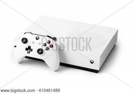 Moscow, Russia - April 18, 2019: Wireless gamepad and Xbox console - isolated on white background.