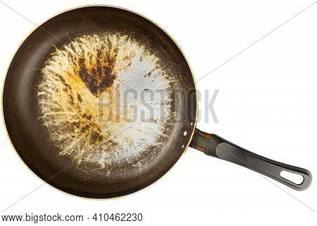 Old Stained Aluminium Pan With Burnt Fat And Peeled Off Tfe Non-stick Coating And Burnt Fat In Flat