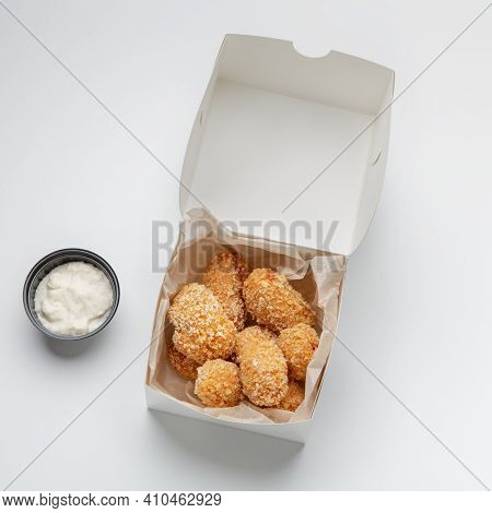 Fried Crispy Snacks And Fast Food Delivery, Yummy Online Order. Savory Nuggets In Paper Box And Sauc