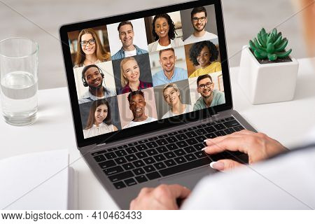 Diverse Businesspeople Having Web Conference Conversation Via Video Call On Laptop Computer, Multiet