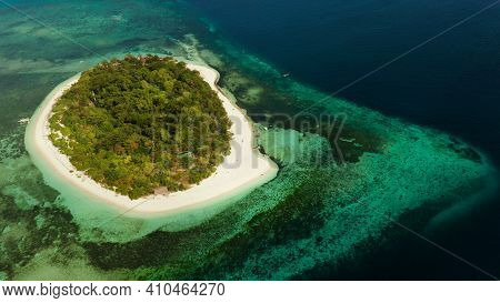 Tropical Island And Sandy Beach Surrounded By Atoll And Coral Reef With Turquoise Water, Aerial Dron