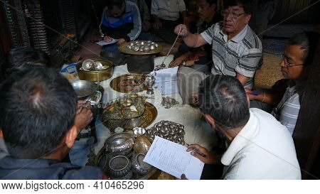 Lalitpur, Nepal - 7 October 2018 Men In A Hindu Temple Hold A Public Inventory Of Treasures And Dona
