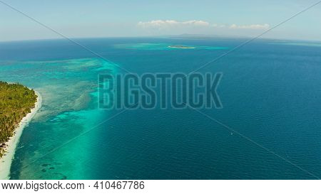 Aerial View Of Sandy Beach On A Tropical Island With Palm Trees By Coral Reef Atoll. Patongong Islan