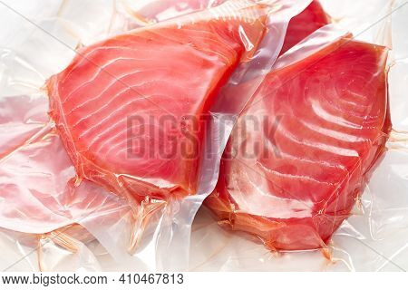 Frozen Tuna Steak Vacuum With Ice On The Counter The Fishmarket. Healfy Food And Nutrition Concept