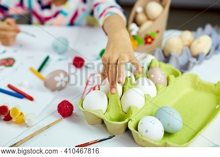 Unrecognizable Little Girl Painting, Drawing With Brush Eggs At Home, Take Egg