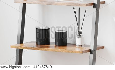 Black Scented Candles With Aroma Reed Diffuser On Wooden Shelf On White Wall Background, Home Aromat