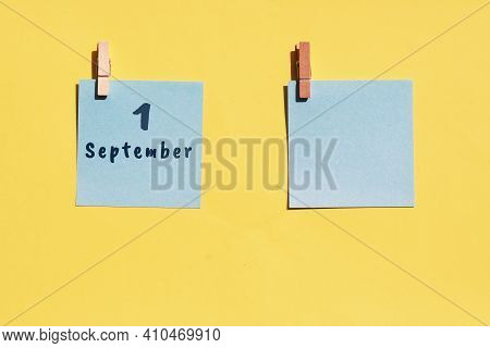 September 1. 1st Day Of The Month, Calendar Date. Two Blue Sheets For Writing On A Yellow Background