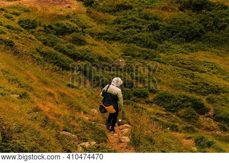One Tourist On The Background Of The Carpathian Mountains, Relaxation And Enjoyment Of Nature And So