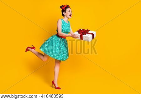 Full Length Body Size View Of Nice Cheery Pretty Girl Wearing Teal Dress Holding N Hand Giftbox Givi