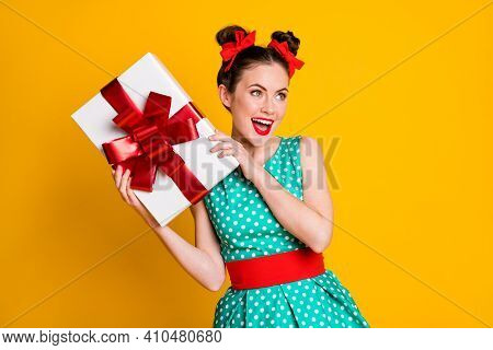 Portrait Of Attractive Cheerful Girl Holding In Hands Romantic Giftbox Occasion Isolated On Vivid Ye