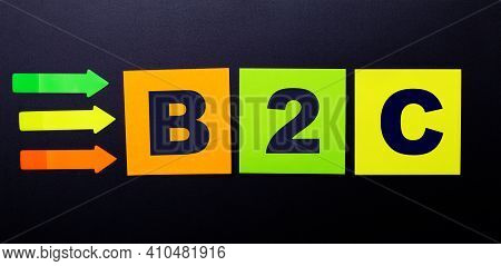 Bright Multi-colored Paper Stickers On A Black Background With The Text B2c