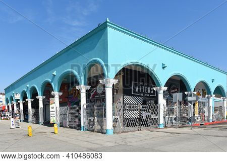 VENICE, CALIFORNIA - 17 FEB 2020: Venice Beach Boardwalk shops, selling CBD products, ice cream, souvenirs and clothing.