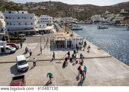 Ios, Greece - September 26, 2020: Tourists Boarding The Ferry In Port Of Ios Island. Cyclades, Greec