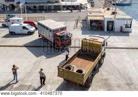 Ios, Greece - September 26, 2020: Trucks Boarding The Ferry In Port Of Ios Island. Cyclades, Greece.