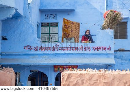 Jaipur, India. 09-05-2018. Old Woman Is Sitting In The Balcony Of Her House Watching The People In T
