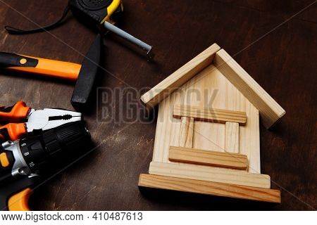 Set Of Different Tools For Repair And Wooden House Close-up. Fixing Concept