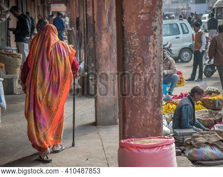 Jaipur, India. 09-05-2018. Old Woman With Stick Is Walking On The Streets Of Jaipur In The Rajasthan